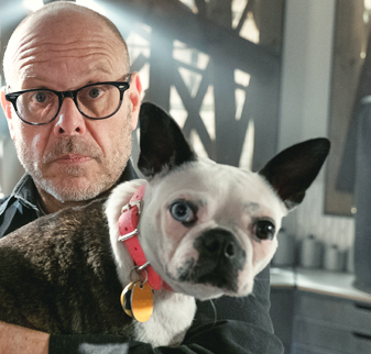 Alton Brown holding a dog