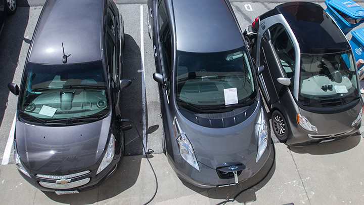 3 electric cars charging.