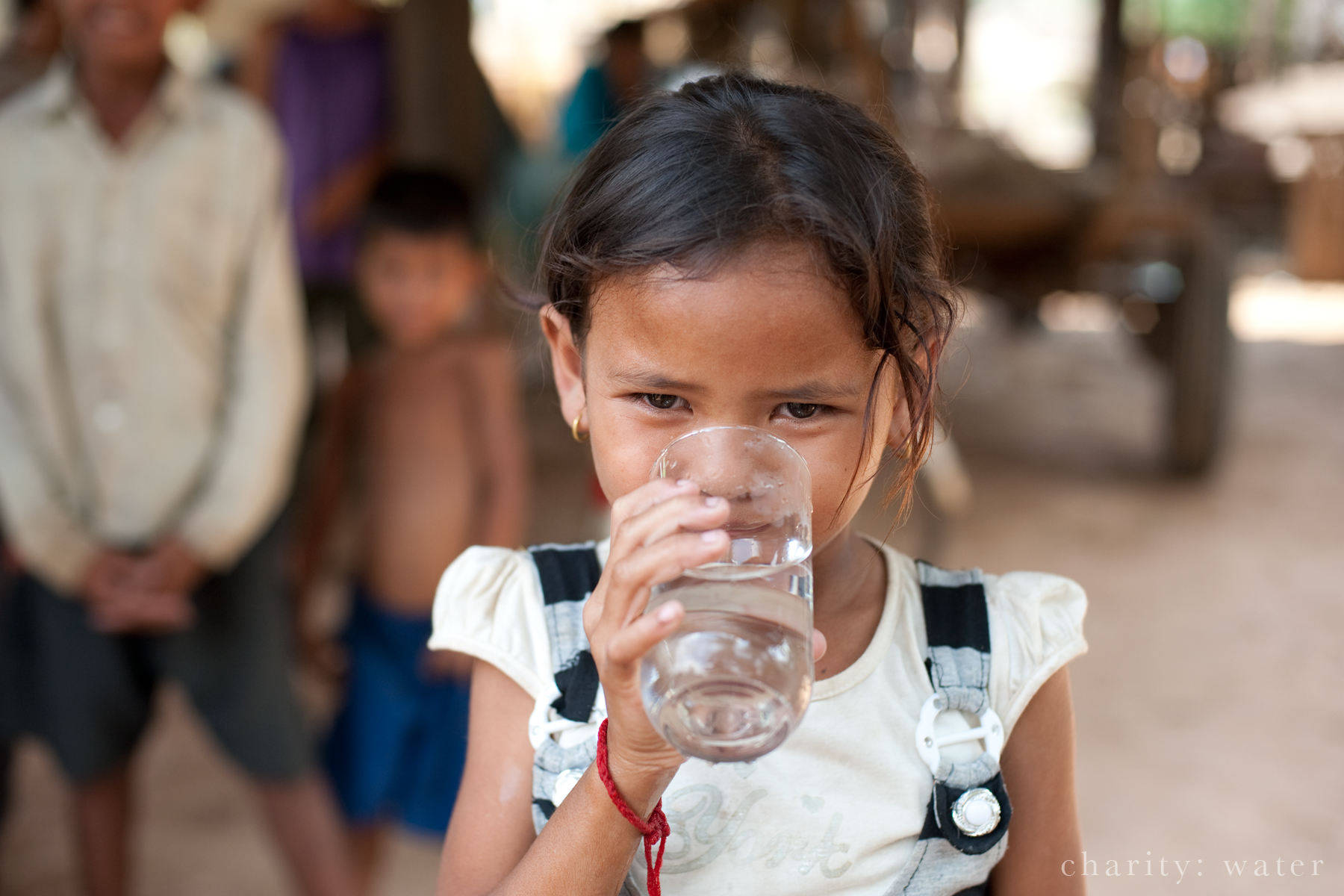 young girl drinkng clean water