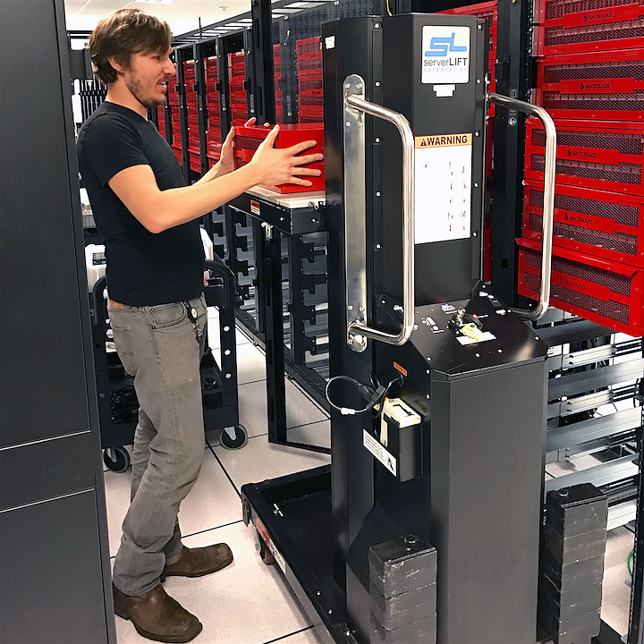 Our server lift, Guido (on the right), helping Joe with the heavy lifting in our data center