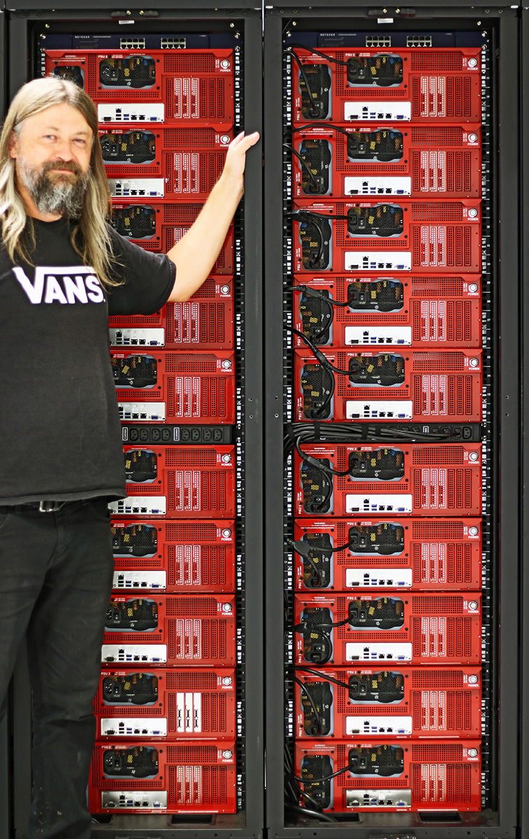 Jon with two Backblaze cabinets, each with 10 Storage Pods, one switch, and one custom PDU