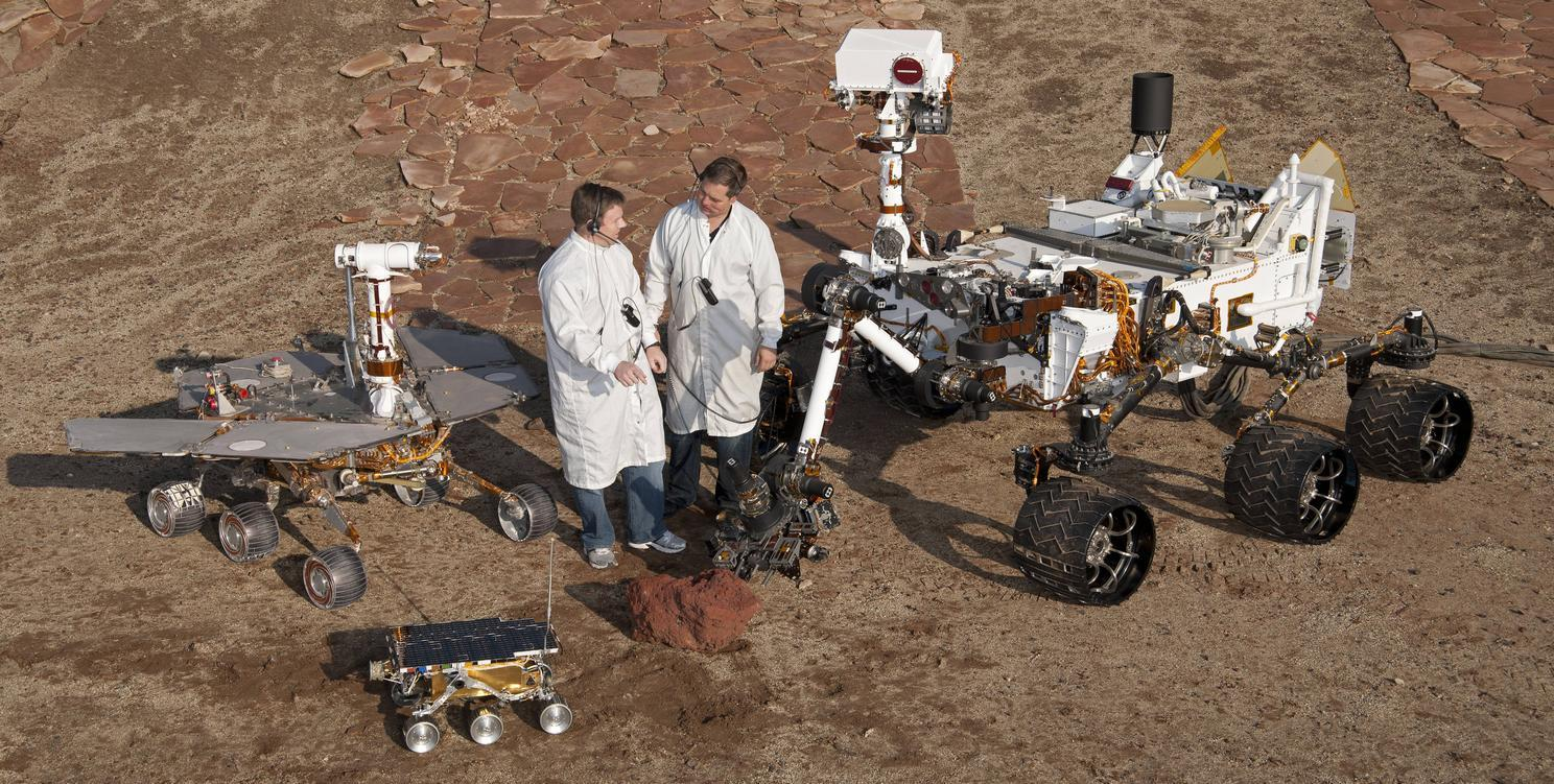 The Mars Rover family, clockwise from bottom left: Sojourner (1997), Spirit/Opportunity (2004), Curiosity (2012)