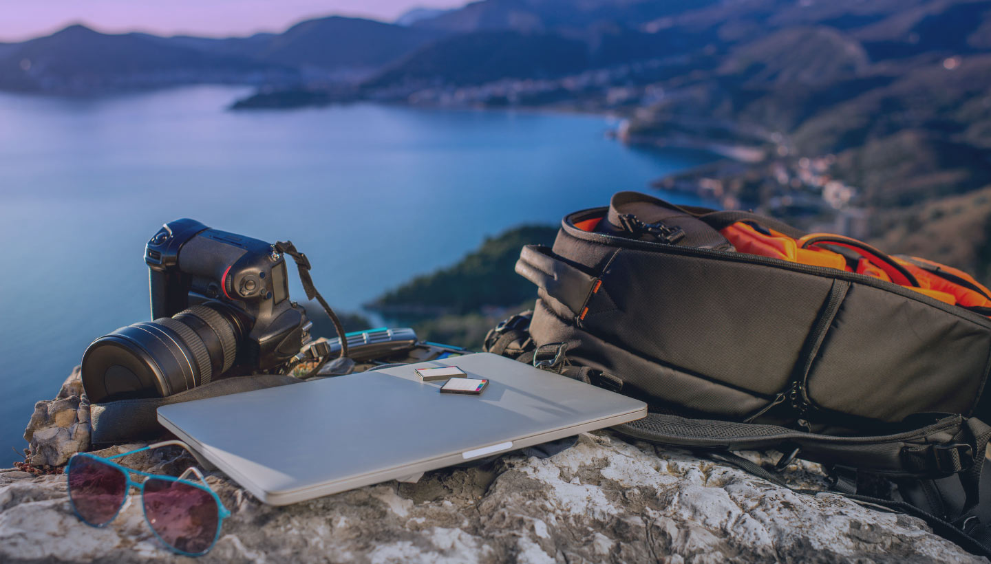 computer and camera overlooking a lake