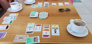A Monopoly Deal game in progress